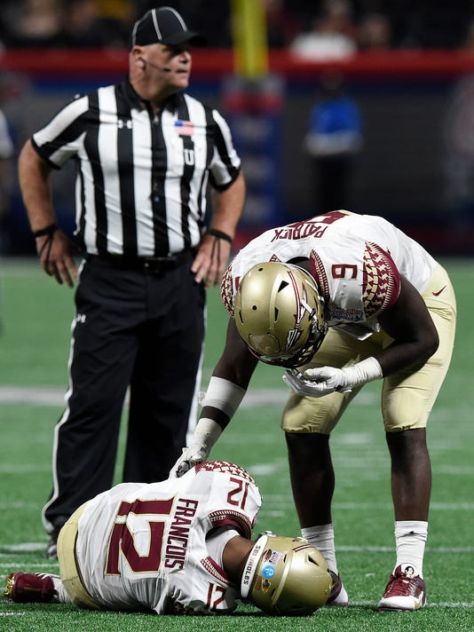 Florida State quarterback Deondre Francois (12) speaks to Florida State running back Jacques Patrick (9) after Francois was injured against Alabama during the second half of an NCAA football game, Saturday, Sept. 2, 2017, in Atlanta. Alabama won 24-7. (AP Photo/Mike Stewart)
