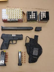 Police found a gun, ammunition and drugs inside the