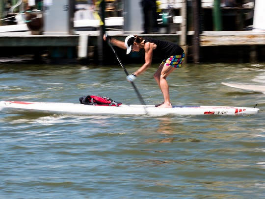 A paddle boarder turns the corner during the paddle
