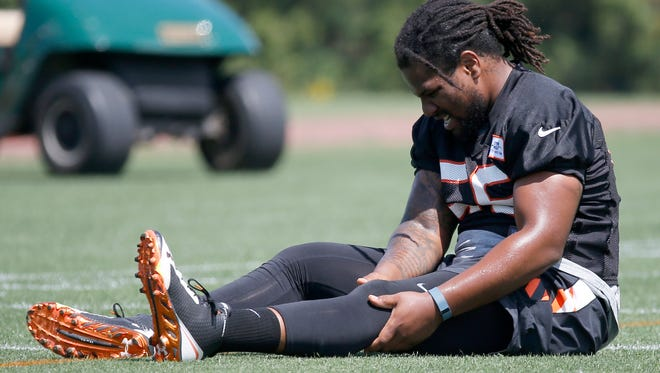 Cincinnati Bengals linebacker Vontaze Burfict rehabilitates his knee after undergoing arthroscopic surgery in January. He worked on a side field during the open of organized team activities on Tuesday, May 26 on the practice fields adjacent to Paul Brown Stadium. The Enquirer/Kareem Elgazzar