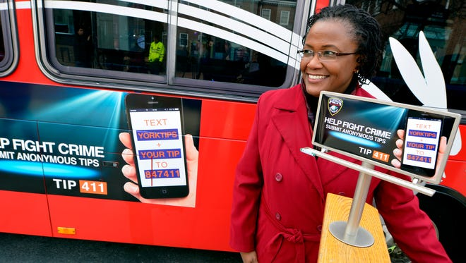 Mayor C Kim Bracey announces new posters and billboards donated by Lamar Advertising to promote the use of TIP 411, an anonymous tip line, Thursday  March 3 2016. John A. Pavoncello photo