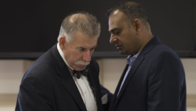 Attorney J. Michael Farrell with former Madison pharmacist Raju Srinivasa. Raju Srinivasa was charged as a co-conspirator with Vincent Esposito for allegedly conspiring to give people Oxycodone without being examined first or without having legitimate prescriptions. The trial is being held at Morris County Court House, Morristown, NJ. Tuesday, May 17, 2016.