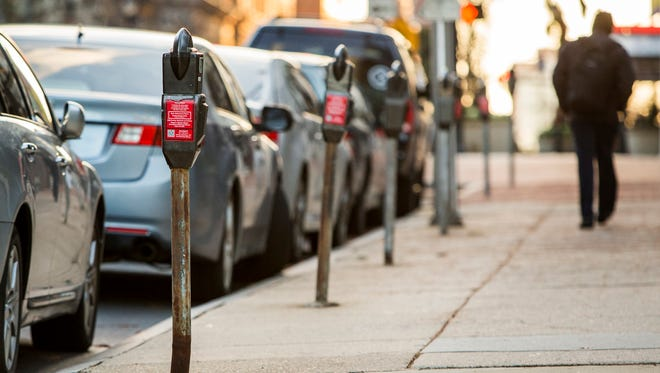 Coin operated parking meters line the 1200 block of North Market Street in December.