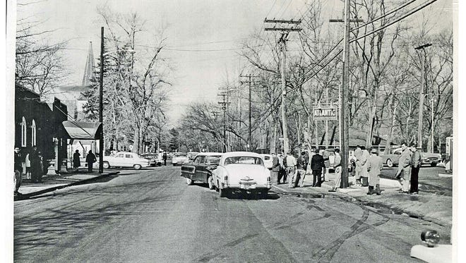Accident gathers a crowd in this historic photo donated by Michael Savia to the historical society.