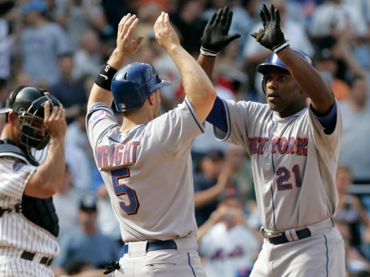 Mets' Carlos Delgado celebrates with David Wright after hitting a grand slam against the Yankees  on June 27, 2008.