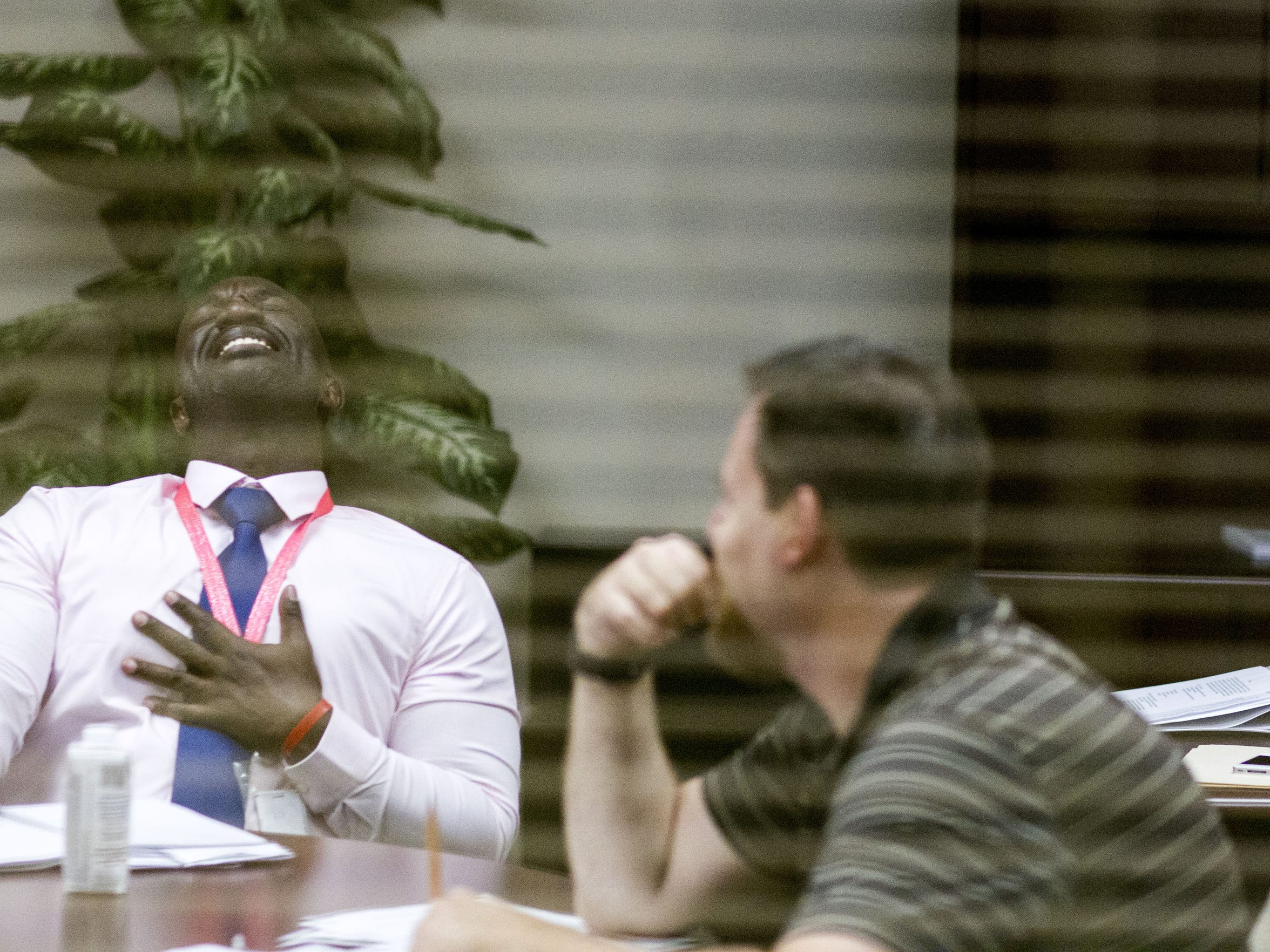 Principal Eric Atuahene, left, shares a laugh while he talks to his administrative staff.