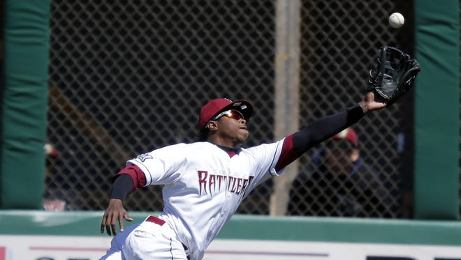 Monte Harrison makes a diving catch for the Wisconsin Timber Rattlers in 2015.