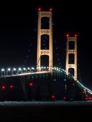 The Mackinac Bridge lit with strings of blue lights on April 2, 2013, as part of an effort to mark awareness of autism.