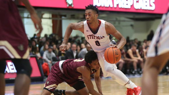Stepinac's Alan Griffin (0) puts a move on Iona's Bryce