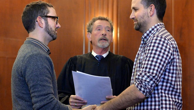 Robert Gann, left, and John Kenny Rodricks, right, were married Nov. 7, 2014, in the Jackson County courthouse in Kansas City, Mo., after a federal judge struck down the state's ban on same-sex marriages.