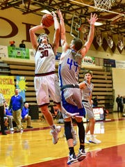 Milford's Gunnar Gustafson (left) goes up for the shot against Lakeland's Cass Phillips.