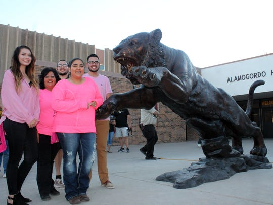 Alamogordo High School student council members Bailey Smelser, Angelica Montoya, Ziggy Arreola and student council sponsor Irma Montoya stand with the new tiger statue. In total, the student councils of 2015 and 2016 raised over $15,000 to purchase the new statue.