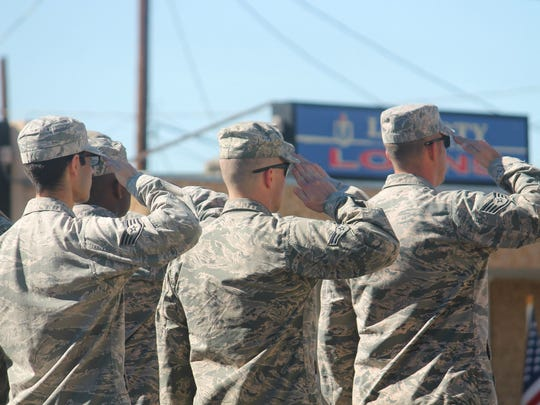 In this file photo, Airmen from Holloman Air Force Base salute during the 2015 Veterans Day parade. This year's parade begins at 10 a.m.