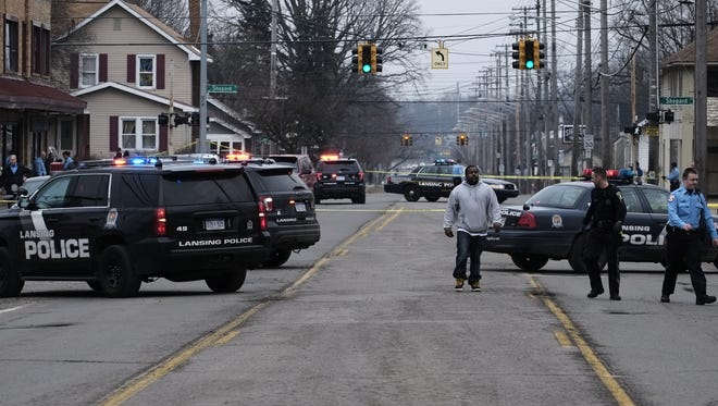 Lansing police had the 1600 block of East Kalamazoo Street blocked because of a shooting in Lansing, Saturday, February 11, 2017.