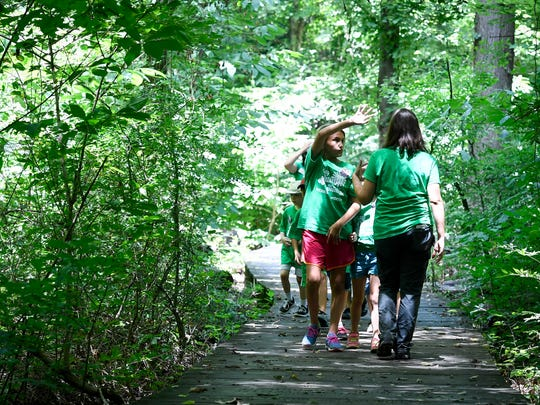Wesselman Park Program Naturalist Alana Fligor answers questions during a hike at the Wesselman Woods day camp Monday.