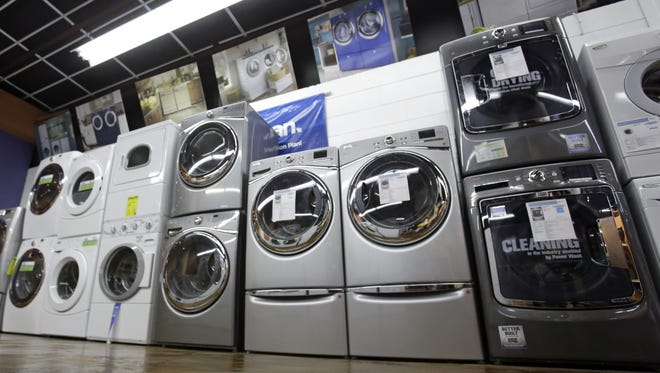 Washers and dryers are displayed at an Aggressive Appliances store in Orlando, Fla.