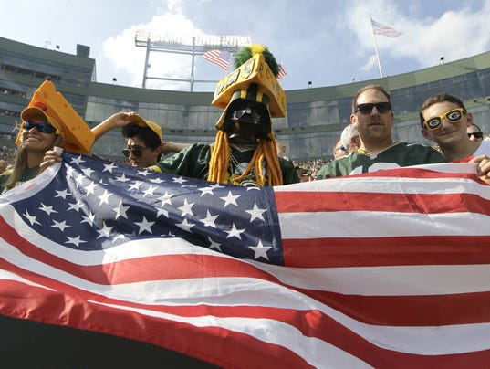 Packers fan with flag