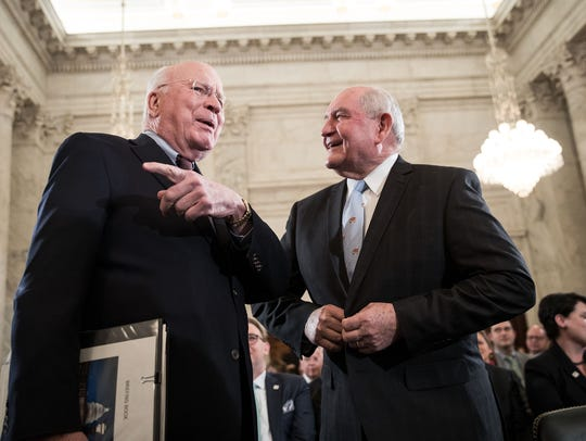 Sen. Patrick Leahy (D-VT) talks with Sonny Perdue,