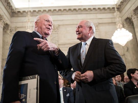 Sen. Patrick Leahy (D-VT) talks with Sonny Perdue,