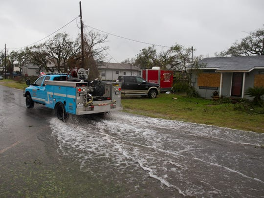 The Fulton Volunteer fire department drive down a flood