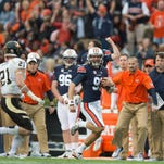 Auburn Tigers punter Kevin Phillips (91) runs for a first down on a fake punt during the NCAA football game between Auburn and Idaho on Saturday, Nov. 21, 2015, at Jordan-Hare Stadium in Auburn, Ala.  Albert Cesare / Advertiser