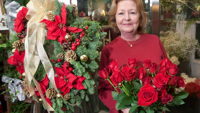 Debbie Reader, owner of Village Florist in Toms River, getting ready for the holidays.