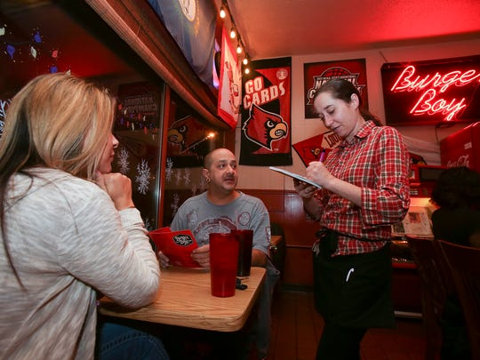 Waitress Maranda Schmitt took an order from Marc Hosler and his wife, Laura Hosler, at the Burger Boy restaurant in Old Louisville.
