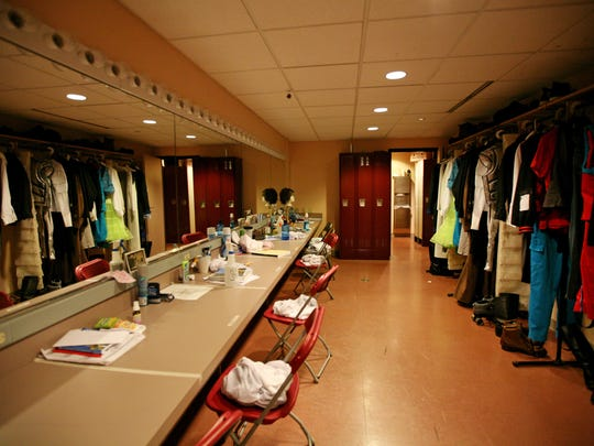 A dressing room empty of actors is lined with costumes at the American Shakespeare Center in this photo taken on July, 2, 2013 in Staunton. The Fair Labor Standards Act would have affected about half of ASC's employees, as it was scheduled to go into effect Dec. 1, but an injunction ruled by a federal judge on Tuesday evening delayed the changes indefinitely nationwide.