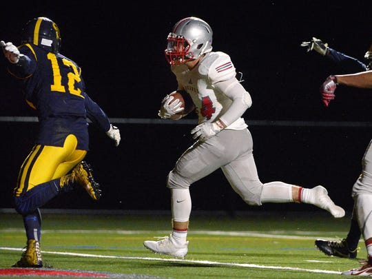 Despite losing a shoe, Canandaigua's Seth Vigneri scores the Braves' second touchdown during a regular season game at Canandaigua Academy on Friday, Sept. 8, 2017. Canandaigua beat Spencerport 21-0.