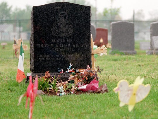 The gravestone of Timothy Wiltsey (above right)  at