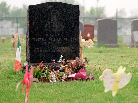 The gravestone of Timothy Wiltsey (above right)  at St. Joseph's Cemetery in Keyport.