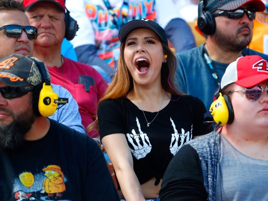 A fan yawns while watching the race at ISM Raceway during the Ticket Guardian 500 on March 11, 2018 in Avondale, Ariz.