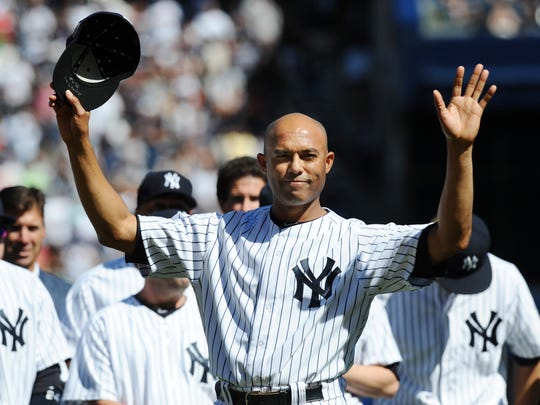 Mariano Rivera waves to the crowd during the Mariano Day ceremony at Yankee Stadium.