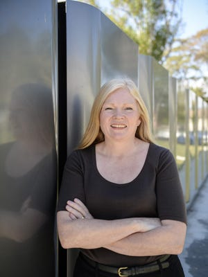 Susan S. Brennan, Bloom Energy's chief operating officer, stands alongside fuel cell membrane assemblies at the company's Sunnyvale, California, plant. Bloom has two installations in Delaware that generate an average 27 megawatts monthly for Delmarva Power.
