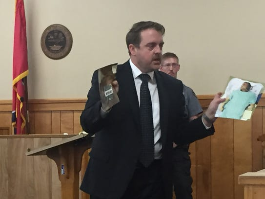 District Attorney Ray Crouch shows photos of Seth Brabant