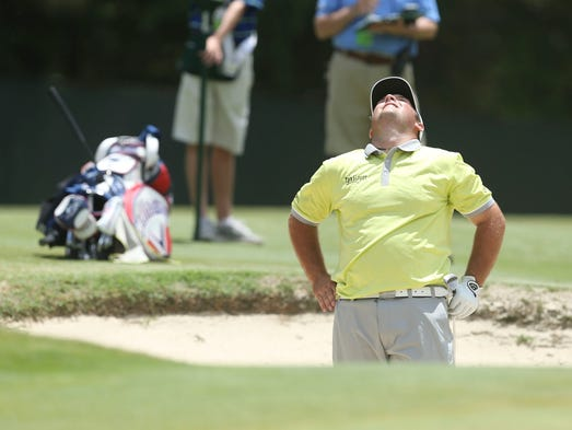 Patrick Reed reacts after his shot on the 9th hole during the first round of the 2014 U.S. Open golf tournament at Pinehurst Resort Country Club