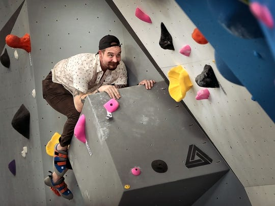 Josh Huskisson struggles up one of over 300 ascent paths at Memphis Rox Climbing, a multi-million-dollar indoor climbing gym and community center which is slated to open on April 3rd at Memphis Mountaintop Media across the street from Stax Museum of American Soul Music.