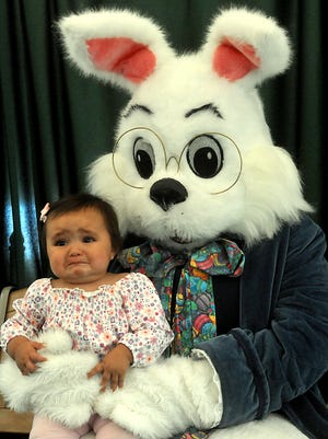 On the verge of crying, Hannah Baca, just shy of one year old, quivers in the lap of the Easter Bunny at the Mesilla Valley Mall in Las Cruces, New Mexico. Send us your (now) funny Easter Bunny photos.