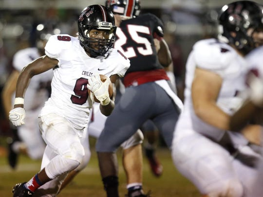 Chiles' Shane Sanders runs the ball against NFC during their game at North Florida Christian on Friday.