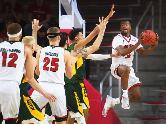 USD's Triston Simpson looks for an open teammate during the game against NDSU Saturday, Dec. 6, at the Sanford Coyotes Sports Center in Vermillion.