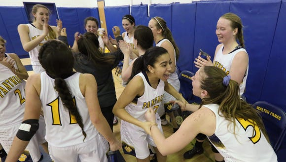 Panas players celebrate after beating Harrison 71-65
