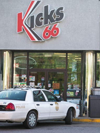 Police on the scene at Kicks 66, where a clerk was shot in the head during an overnight robbery at the gas and convenience store at West Troy Avenue and South Lynhurst Drive, June 5, 2014.