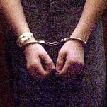 Illustration of person in handcuffs.