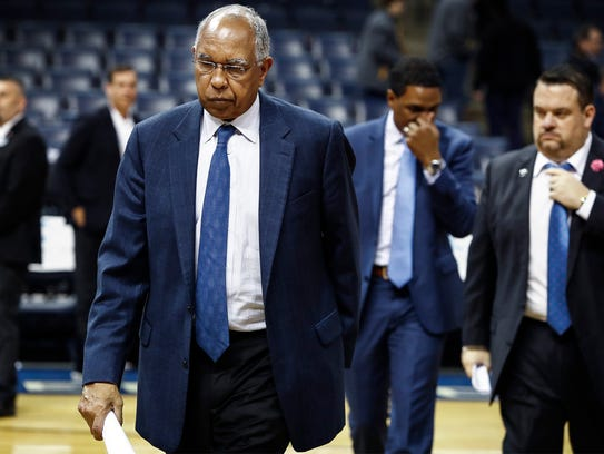 Memphis head coach Tubby Smith walks off the court