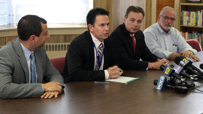 """Members of the Sayreville Board of Education hold a press conference at the Selover School in South Amboy to address the media about a hazing incident that """"went too far"""" is at the center of the investigation into the Sayreville War Memorial High School football team that caused the postponement of last night Sayreville vs South Brunswick football game.   Here  (L to R) attorney Jonathan Busch, Dr. Richard Labbe, Superintendent of Sayreviile Schools, Kevin Ciak, Sayreville Board of Education President and James Brown principal of Sayreville War Memorial High School address the media and parents.   On Friday October 3,,2014 Photo: Mark R. Sullivan/Staff Photographer"""