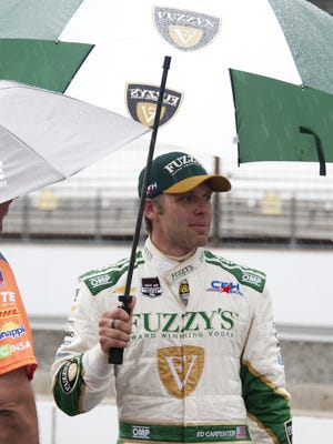 Ed Carpenter (20) of CHF Racing tries to stay dry during qualifying at the Indianapolis Motor Speedway. Saturday, May 16, 2015