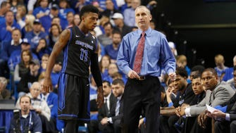 Nov 16, 2014: Former Buffalo head coach Bobby Hurley (R) talks with guard Shannon Evans (11) against the Kentucky Wildcats in the second half at Rupp Arena. Kentucky defeated Buffalo 71-52.