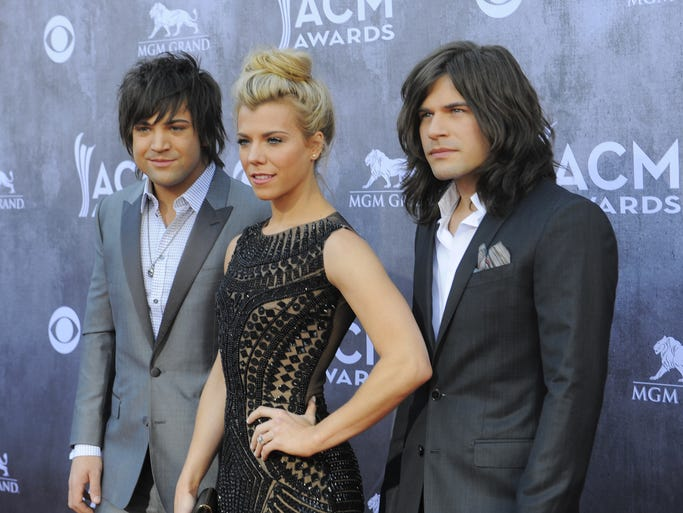 Neil Perry, from left, Kimberly Perry and Reid Perry of The Band Perry attend the 49th annual Academy of Country Music Awards at the MGM Grand Garden Arena in Las Vegas Sunday, April 6, 2014.