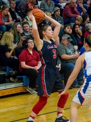 Creek Wood's Raegan Hohl looks for a teammate to pass to against Harpeth.