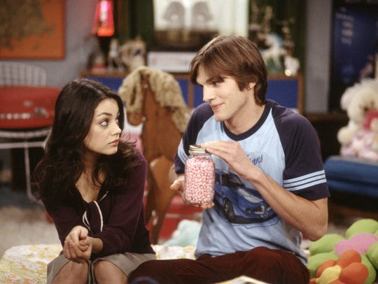 "Jackie (Mila Kunis), left, and Kelso (Ashton Kutcher) were a couple on ""That '70s Show"" and they're now married in real life."